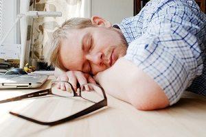 guy sleeping at desk